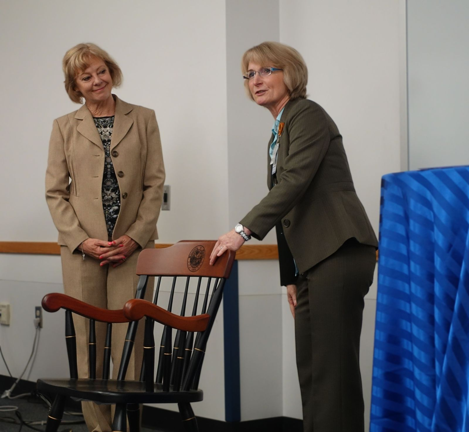 Kathy Christensen receives memorial chair from Interim Chair, Regina Bussing, MD