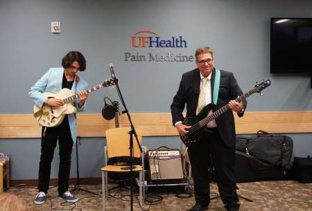 Dr. Leo Rodriguez and his son play an original song for the crowd