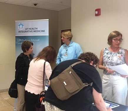 Attendees visit conference fair tables for more information