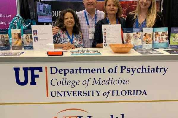 Spence, Creelman, Marika, and Britany at APA booth
