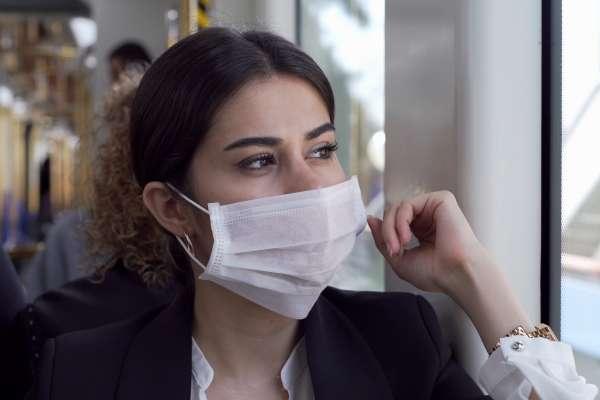 girl wearing mask on train