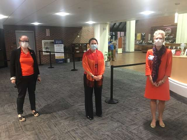 Jacqueline Hobbs, MD, PhD; Julia Close, MD; and Michele Lossius, MD, FAAP dressed in orange for World Patient Safety Day